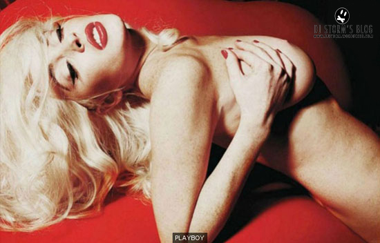Lindsay Lohan Snaps a Topless Photo in Dressing Room,