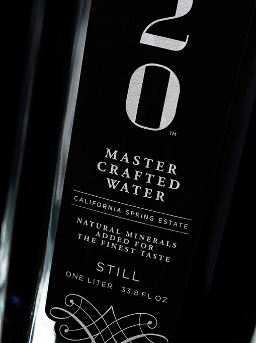 9OH2O_ONE_LITER_GLASS_STILL_BOTTLE_CLOSEUP_ON_BLACK_MAX_10_WEB